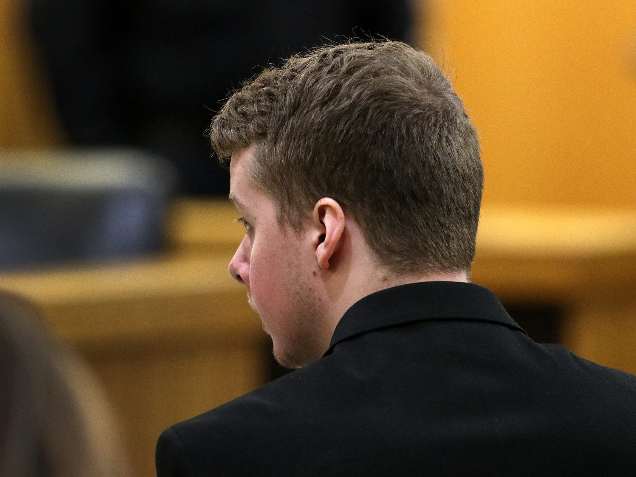 Liam McAtasney, who is charged with the murder of former high school classmate, Sarah Stern, speaks to his lawyer, Carlos Diaz-Cobo,  before jurors rewatch the video evidence they requested during their deliberations before Superior Court Judge Richard W. English at the Monmouth County Courthouse in Freehold, NJ Tuesday, February 26, 2019.