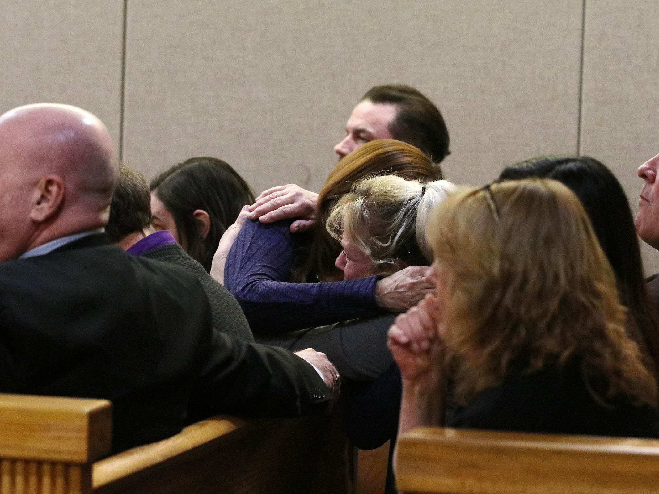 Kristine Eckert, the girlfriend of Sarah Stern's father, MIchael Stern, hugs a woman behind her as the jury finds Liam McAtasney, who is charged with the murder of former high school classmate, Sarah Stern, guilty on all charges before Superior Court Judge Richard W. English at the Monmouth County Courthouse in Freehold, NJ Tuesday, February 26, 2019.
