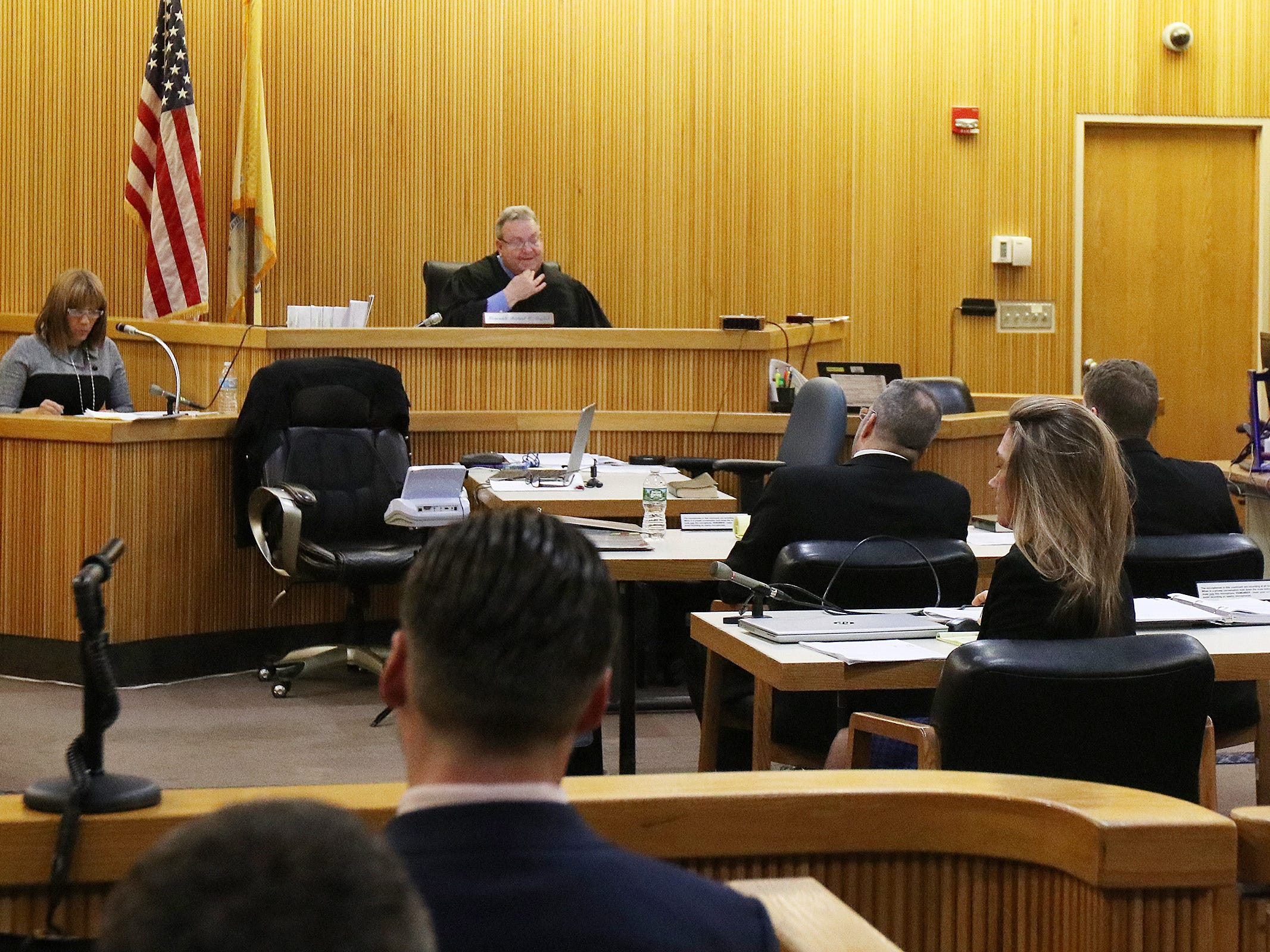 The court reporter reads back some of the testimony of Preston Taylor requested by the jury during their deliberations in the trial of Liam McAtasney, who is charged with the murder of former high school classmate, Sarah Stern, before Superior Court Judge Richard W. English at the Monmouth County Courthouse in Freehold, NJ Tuesday, February 26, 2019.