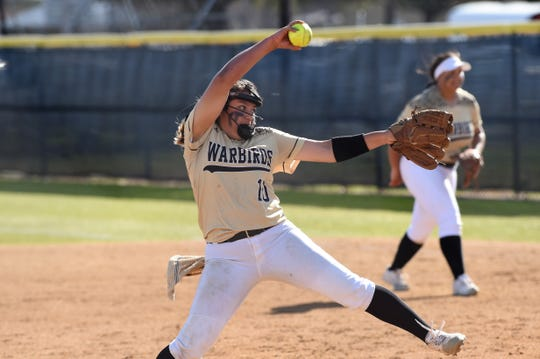 Abilene High pitcher Kaylen Washington (10) goes through her windup against Richland High on Tuesday, Feb. 26, 2019. Washington gave up one run on two hits with 13 strikeouts in the complete-game, 5-1 victory.