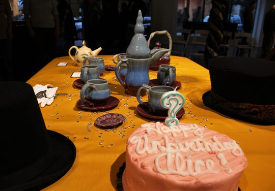 "The table is set for tea with Alice, one of several tea-themed displays, most by Kathie Walker-Millar, for ""Full Tilt Tea Party"" at The Center for Contemporary Arts."