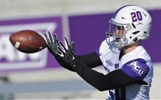 ACU running back Billy McCrary catches a pass during a drill as the Wildcats began spring football practice Feb. 26 at Wildcat Stadium. The Wildcats are planning to get McCrary more involved in the passing game.