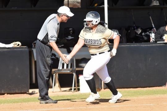 Abilene High's Sydnee Killam (4) gives head coach Jim Reese a high-five after hitting a three-run home run against Richland High on Tuesday, Feb. 26, 2019.