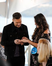 """American Idol"" host Ryan Seacrest checks out Courtney Penry's engagement ring. The Abilene contestant became engaged during her auditions."