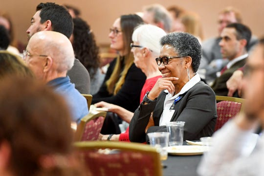 Asheville City Manager Debra Campbell listens to the annual State of Downtown luncheon at the U.S. Cellular Center Feb. 26, 2019.