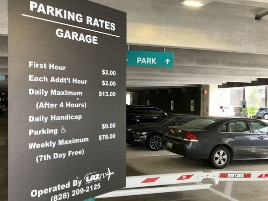 Asheville Regional Airport has installed signage to clearly explain parking rates at its new deck.