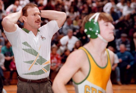 1996: Tim Jenks, Greene wrestling coach on sidelines during JC/Greene match earlier this month.