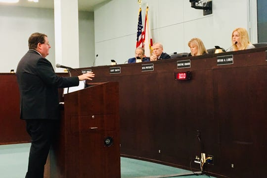 Florida Rep. Randy Fine addresses the Brevard County Commission on Tuesday about his Indian River Lagoon-related bill. On the dais, from left, are County Manager Frank Abbate, County Commissioners Curt Smith and Rita Pritchett, and County Commission Chair Kristine Isnardi.