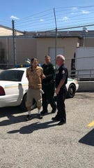Sheriff Wayne Ivey and Satellite Beach Police Chief Jeff Pearson personally walked Suthann into jail Monday. Suthann, 37, was charged with animal cruelty after Ivey said he maimed a disabled veteran's service dog.