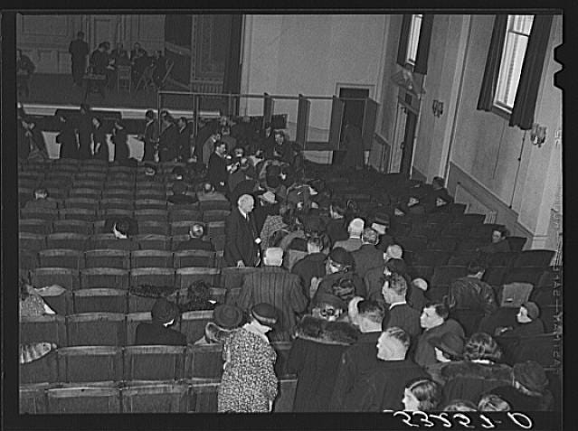 People line up on Town Meeting Day in Woodstock, Vermont. Photograph created/published March 1940. Marion Post Wolcott, 1910-1990.