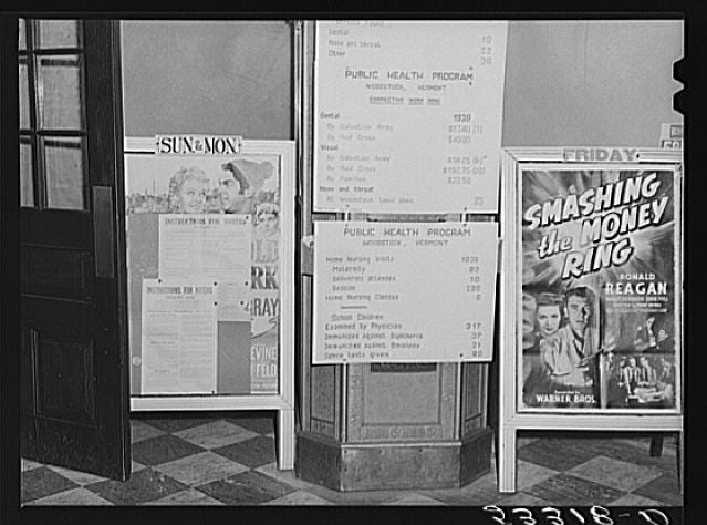 "The entrance to Woodstock, Vermont's town hall on Town Meeting Day (""movies are shown here evenings"")  is pictured. Photograph created/published March 1940. Photographer Marion Post Wolcott, 1910-1990."