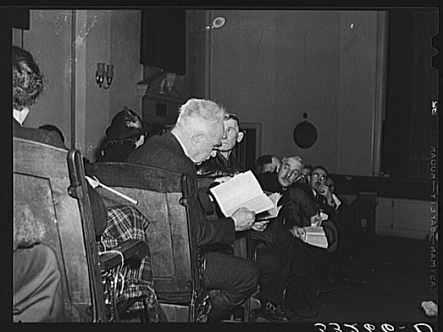 "Woodstock townspeople settle in on Town Meeting Day in Vermont. One of the issues discussed was the sale of ""intoxicating liquors."" Photograph created/published March 1940. Photographer Marion Post Wolcott, 1910-1990."