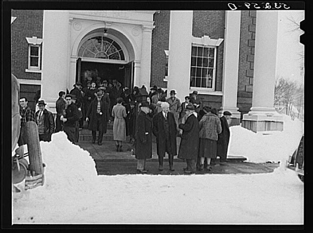 People gather outside on Town Meeting Day in Woodstock, Vermont. Photograph created/published March 1940. Photographer Marion Post Wolcott, 1910-1940.