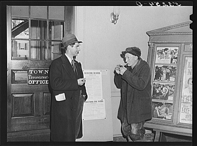 Two men hang out during a break on Town Meeting Day in Woodstock, Vermont. Photograph created/published March 1940. Photographer Marion Post Wolcott, 1910-1990.