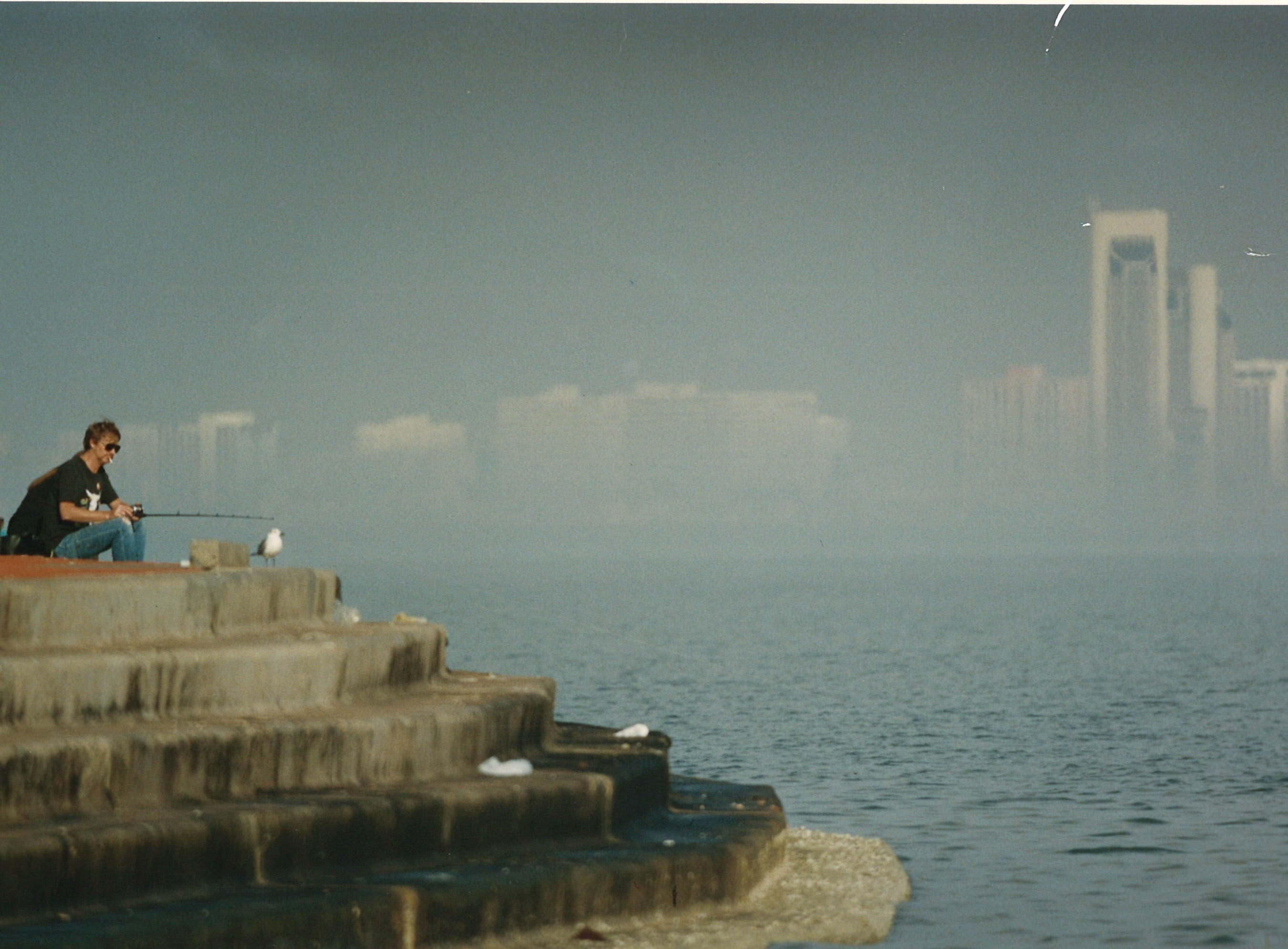 Don and Mary Richardson fish at Swantner Park in December 1993. In the background, downtown Corpus Christi is partially obscured by fog.