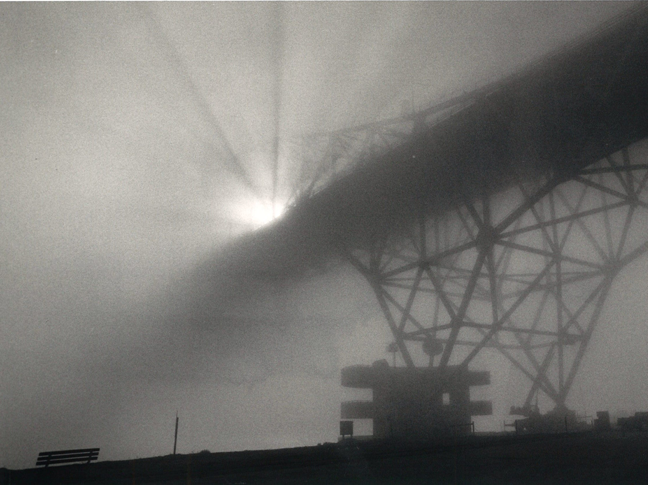 The sun scatters light through the fog-shrowded Harbor Bridge in Corpus Christi on Jan. 20, 1986.