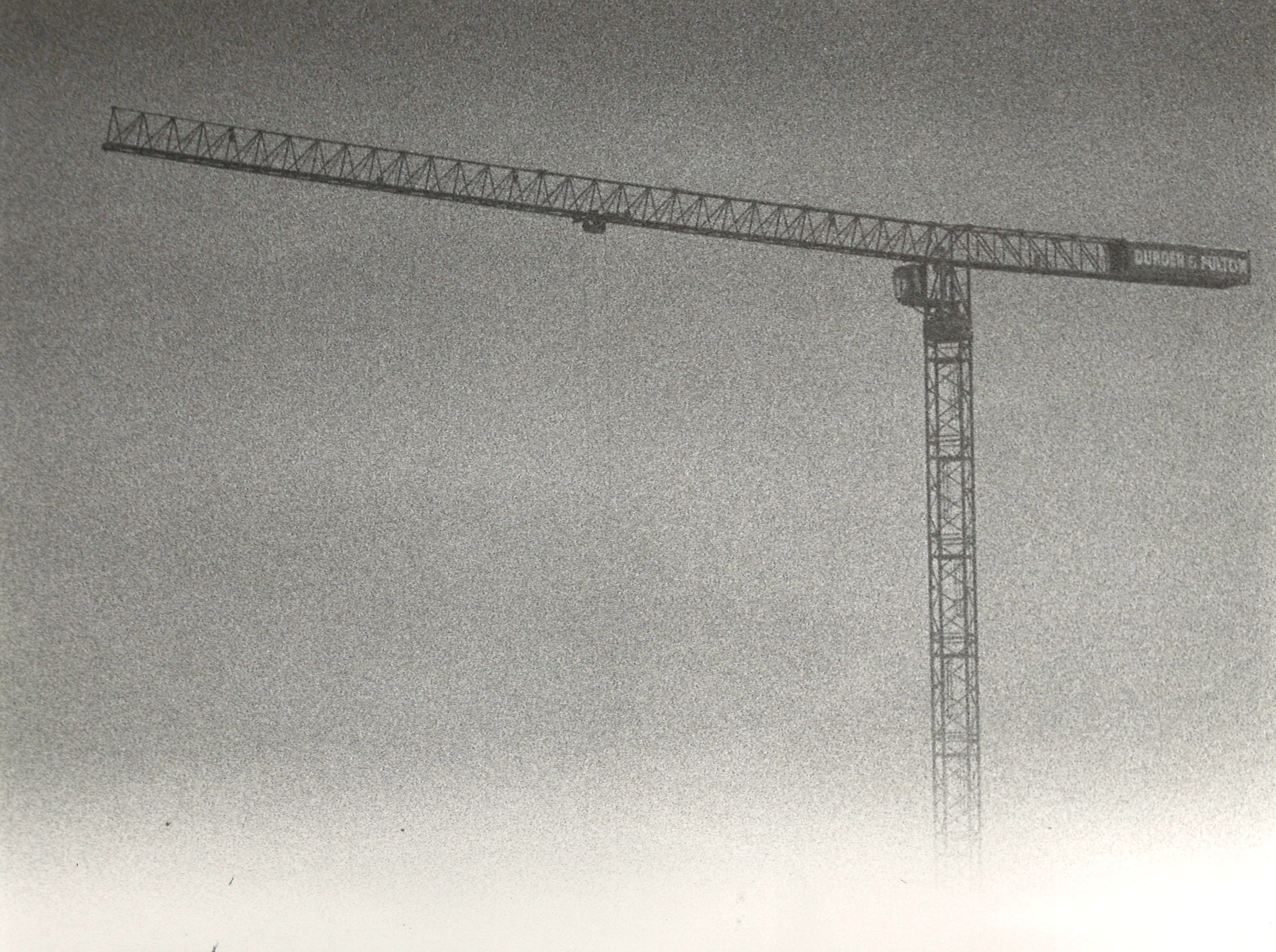 A Durden & Fulton Construction crane is partially obscured by fog during the construction of the Hershey Hotel on Corpus Christi's bayfront on Jan. 6, 1984.
