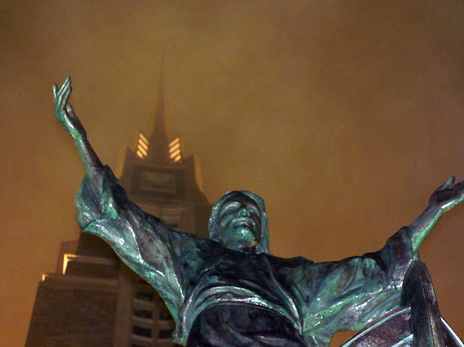 "First United Methodist Church's spire and statue ""It is I"" disappears into the fog in downtown Corpus Christi on Feb. 22, 2001."