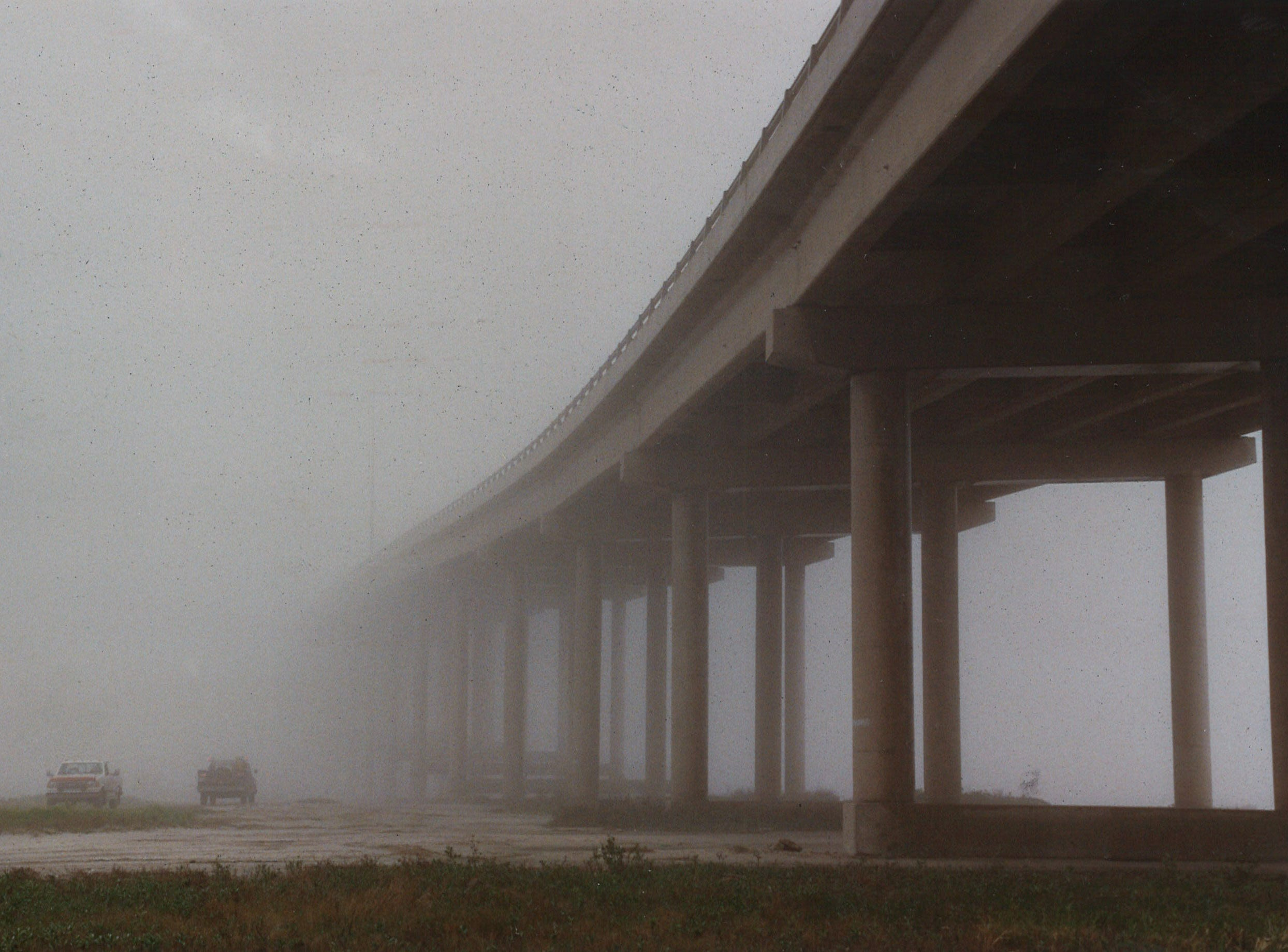 The John F. Kennedy Memorial Causeway in Corpus Christi disappears into the fog on Jan. 3, 1993.