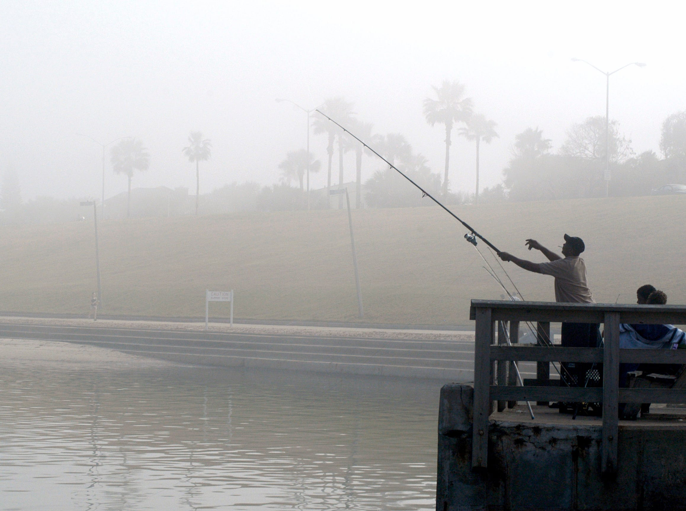 Fisherman cast their lines off the Cole Park pier on Dec. 25, 2008 depsite the heavy fog.