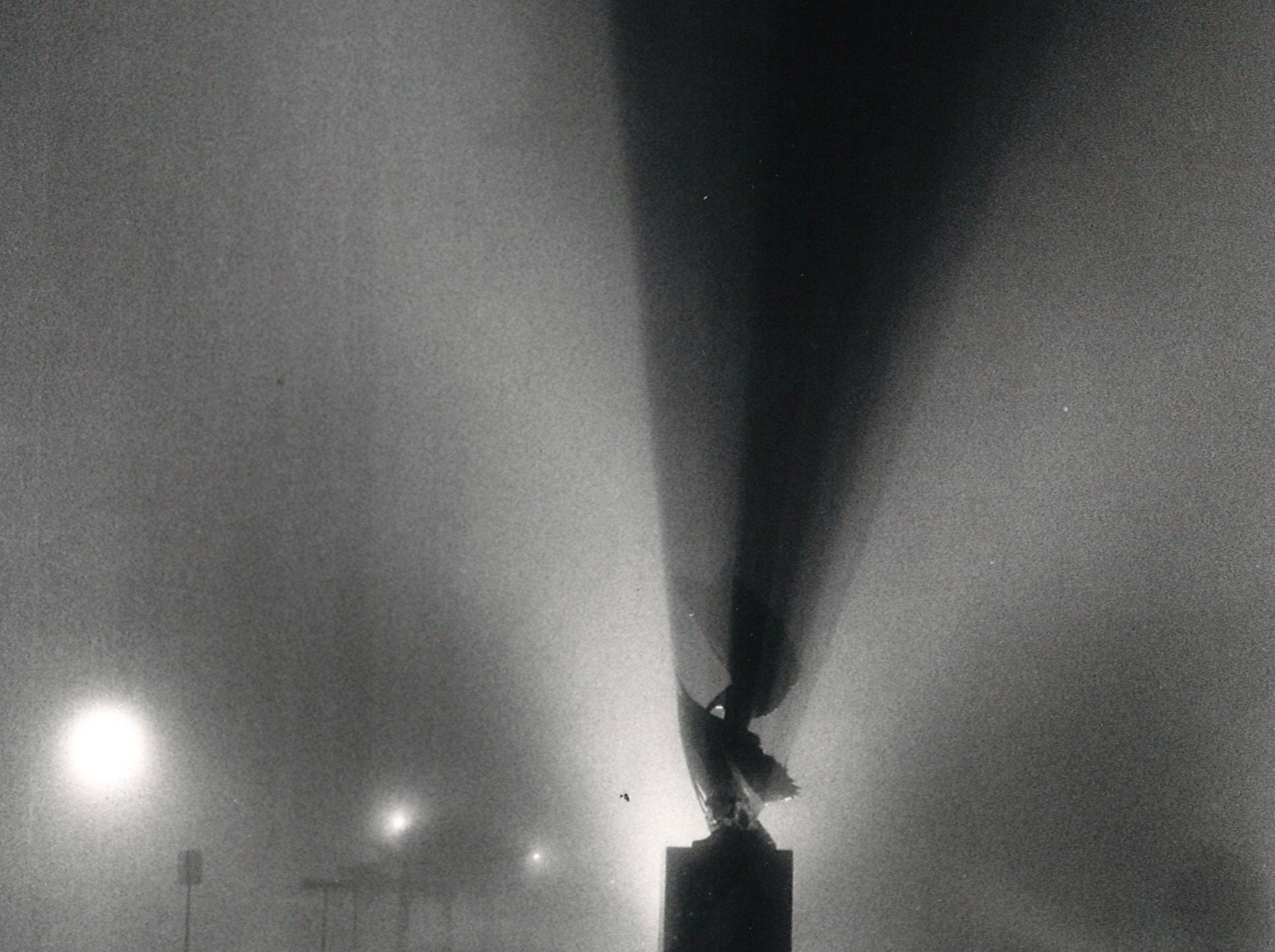 "The Kent Ullberg sculpture ""Wind in the Sails"" on Shoreline Blvd in downtown Corpus Christi looks eerie in the evening fog on April 1, 1988."