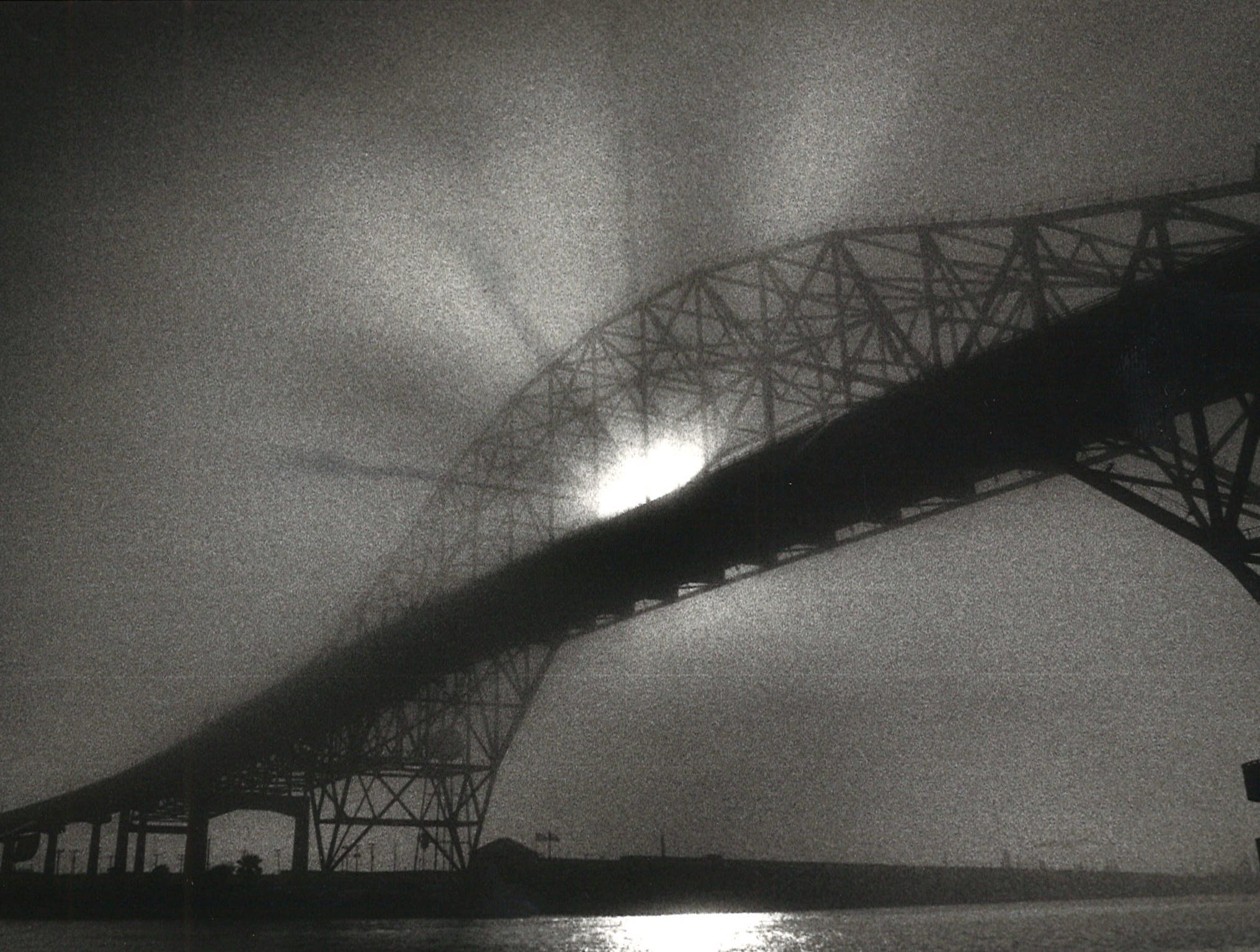 Sun streaks through the beams of the Harbor Bridge in COrpus Christi on Feb. 1, 1988.