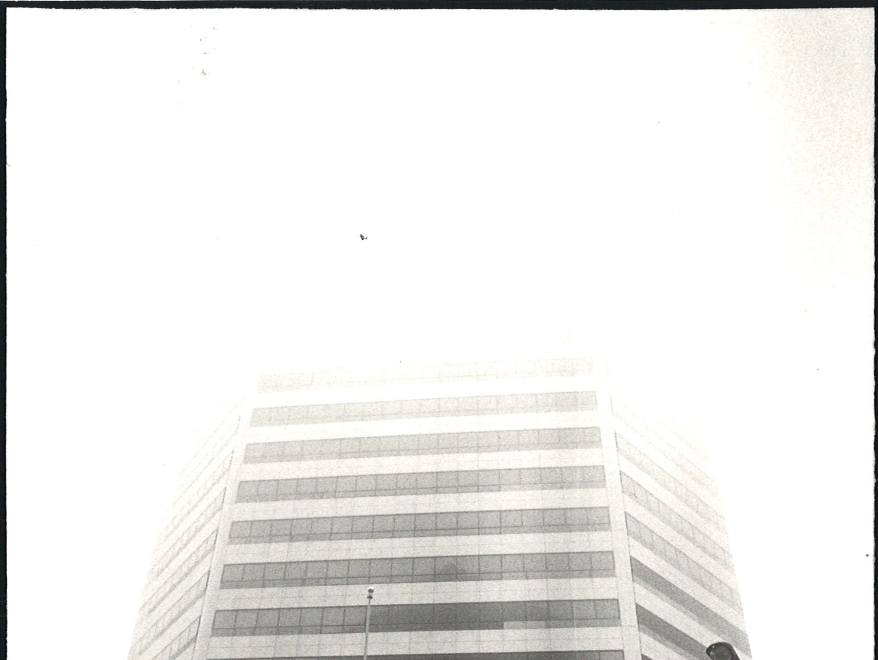 The upper stories of the Texas Commerce Plaza building in uptown Corpus Christi disappear into the fog on Jan. 8, 1984.