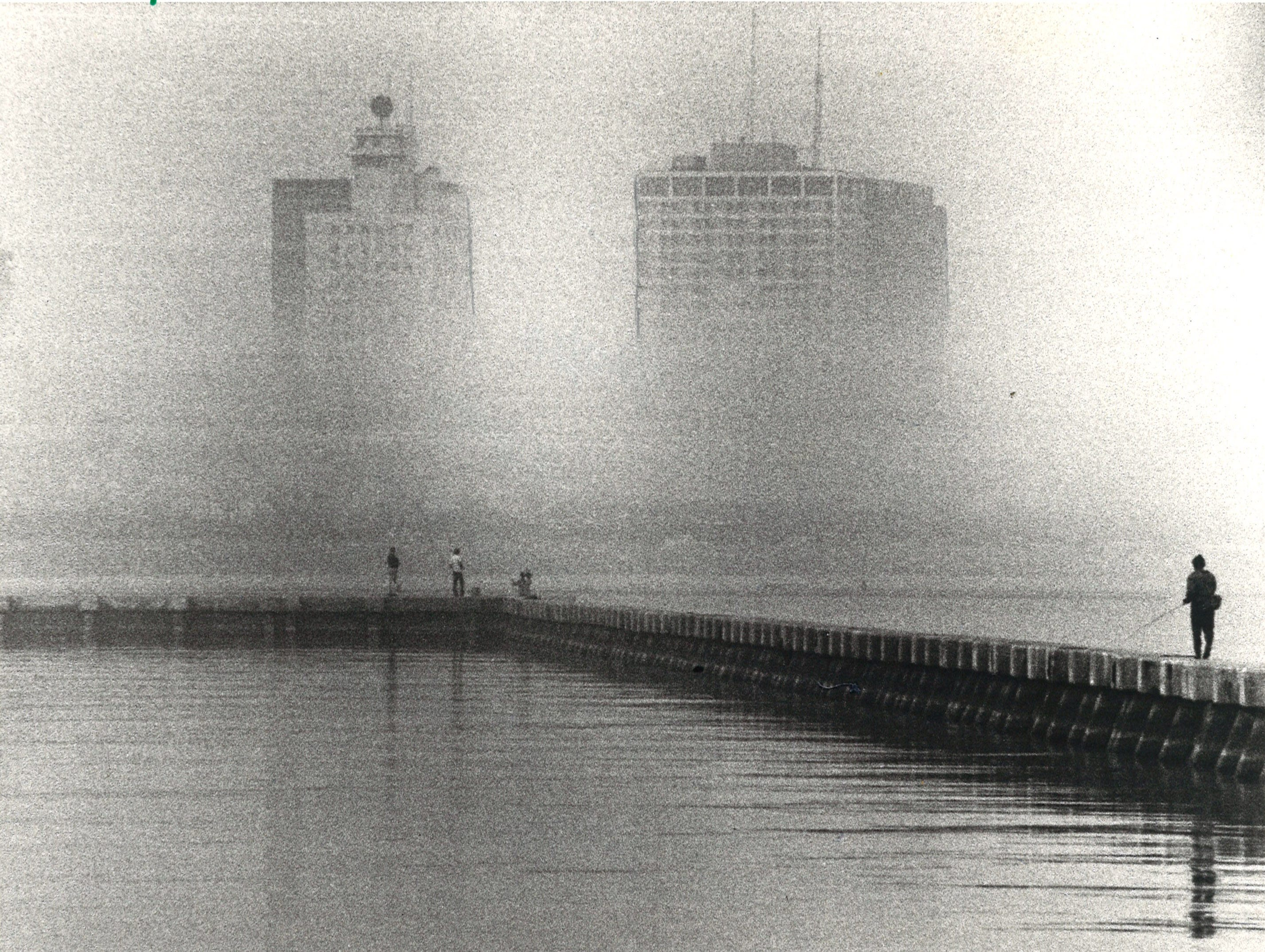 Fisherman are shrouded in fog in front of Spohn Hospital in Corpus Christi on Dec. 18, 1978.