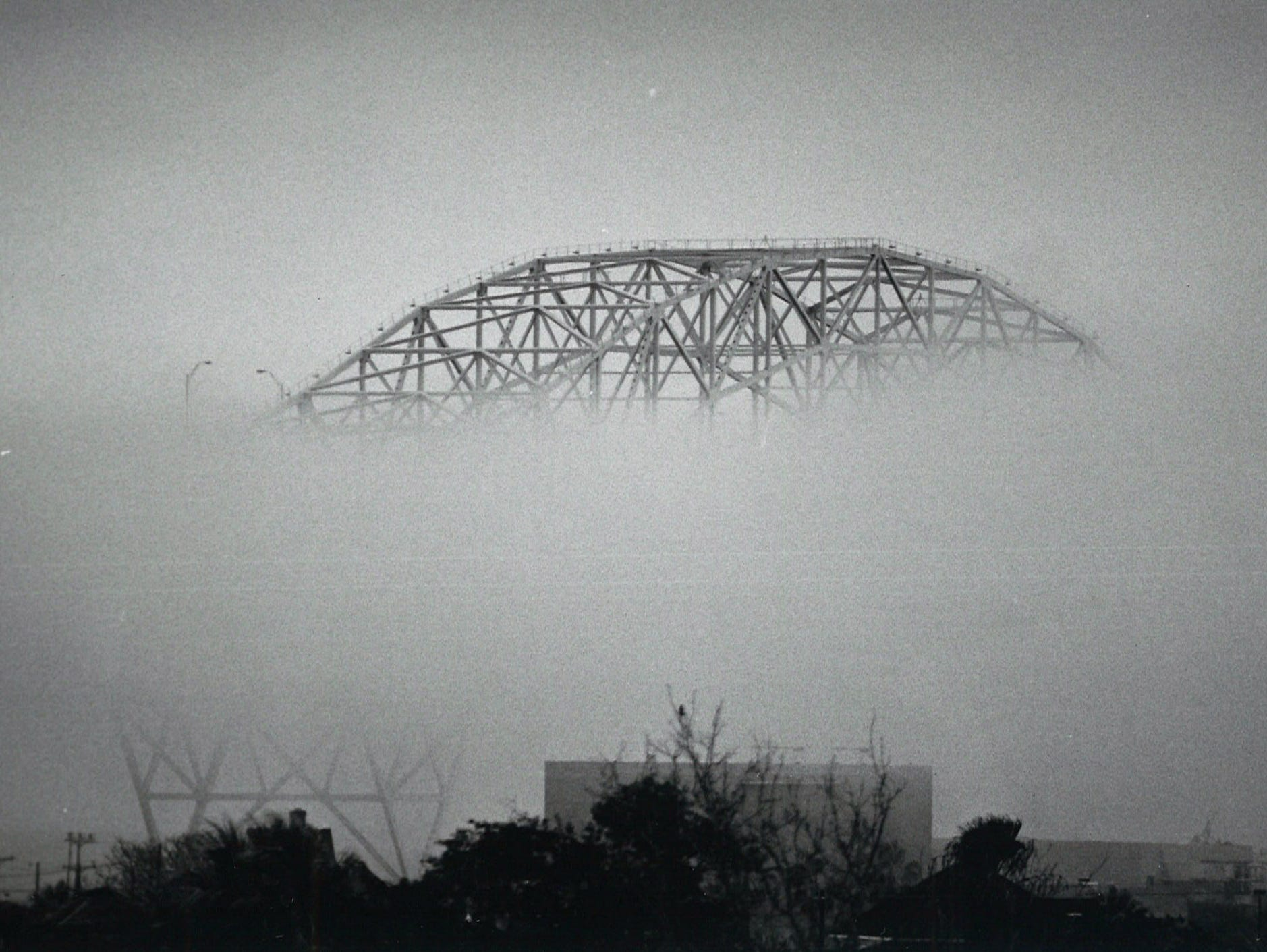 The Harbor Bridge nearly enshrouded by fog in Corpus Christi on Dec. 28, 1989.