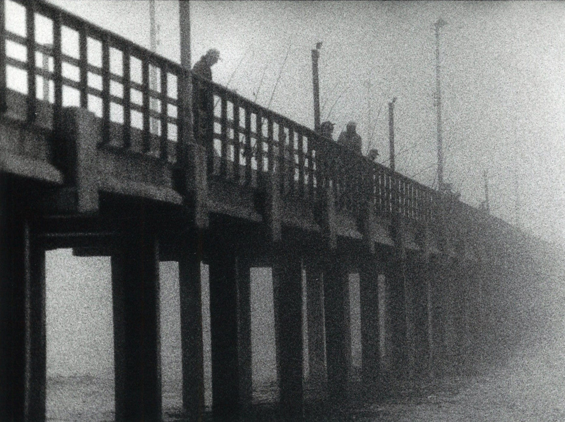 Fishermen try their luck on a foggy Bob Hall Pier on Jan. 23, 1990 in Corpus Christi.
