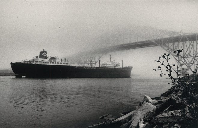 A ship passes under the Harbor Bridge in Corpus Christi on a foggy day in January 1987.