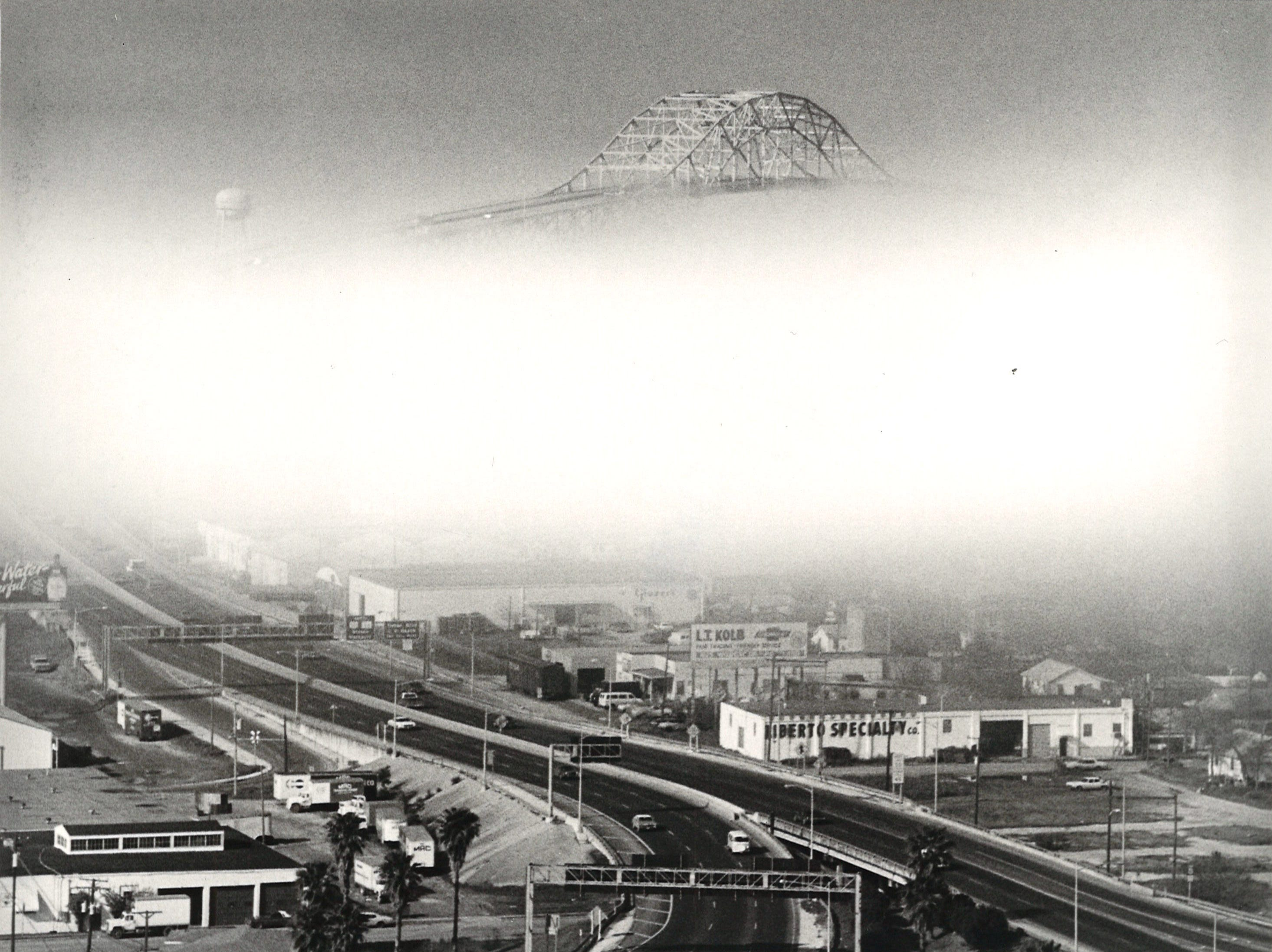 The Harbor Bridge is barely visible in downtown Corpus Christi in heavy fog in February 1980.