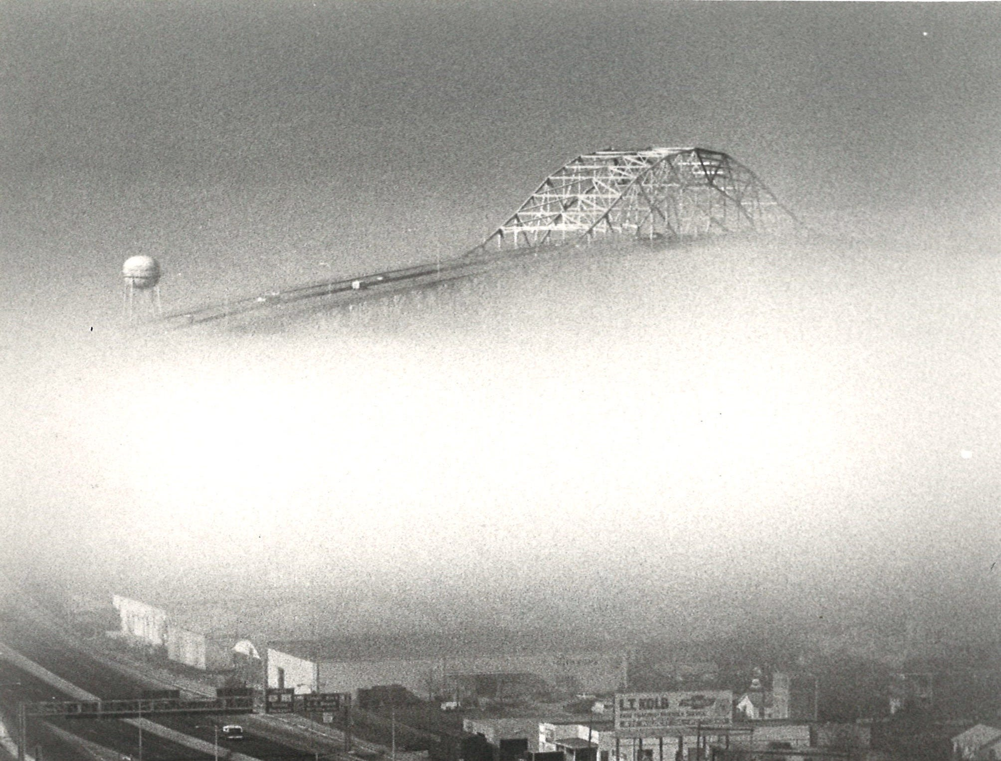 The Harbor Bridge in Corpus Christi hides behind the fog in downtown in February 1980.