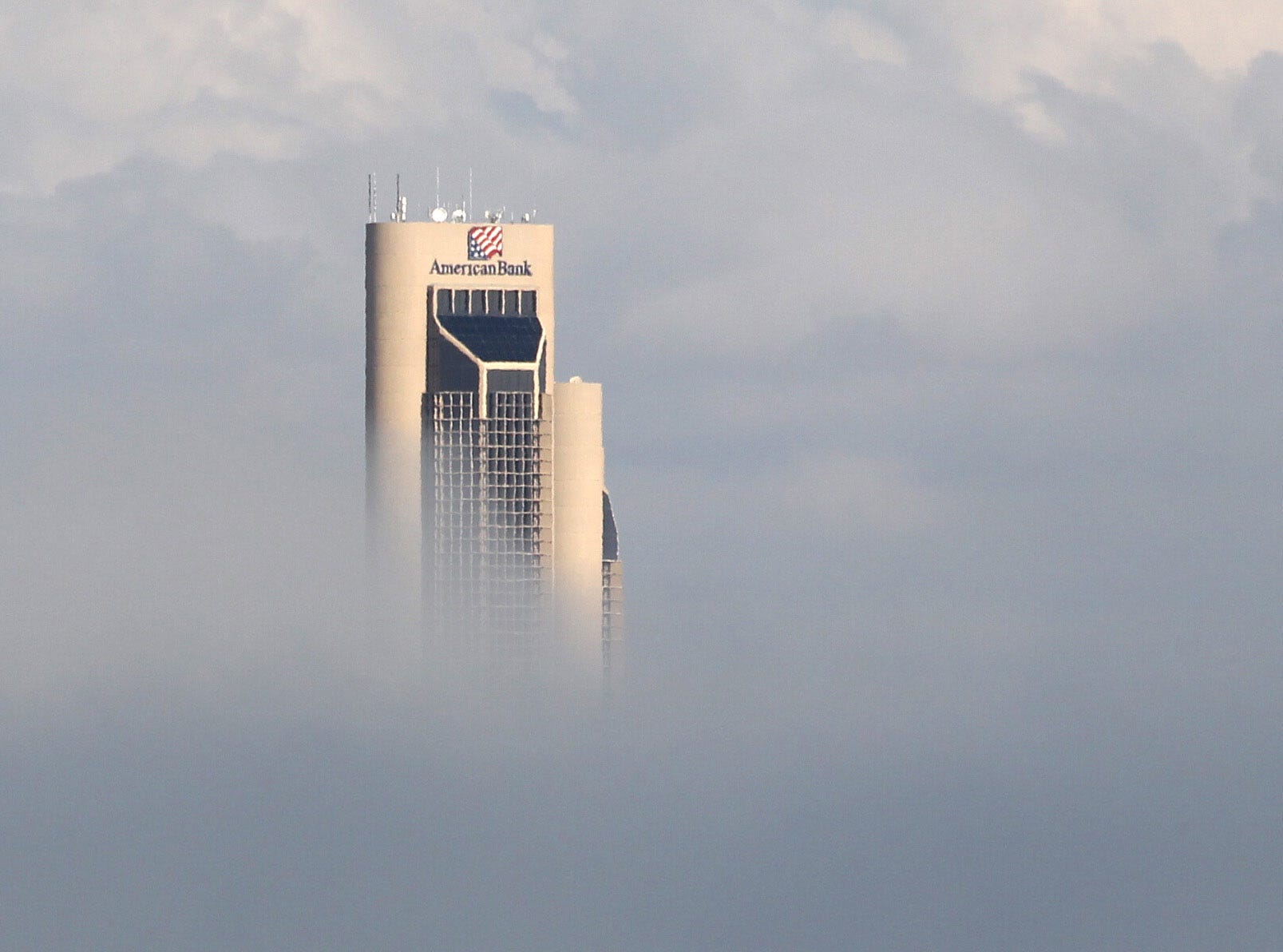 One Shoreline Plaza Tower peeks out from the fog that blanketed the area Oct. 31, 2012.