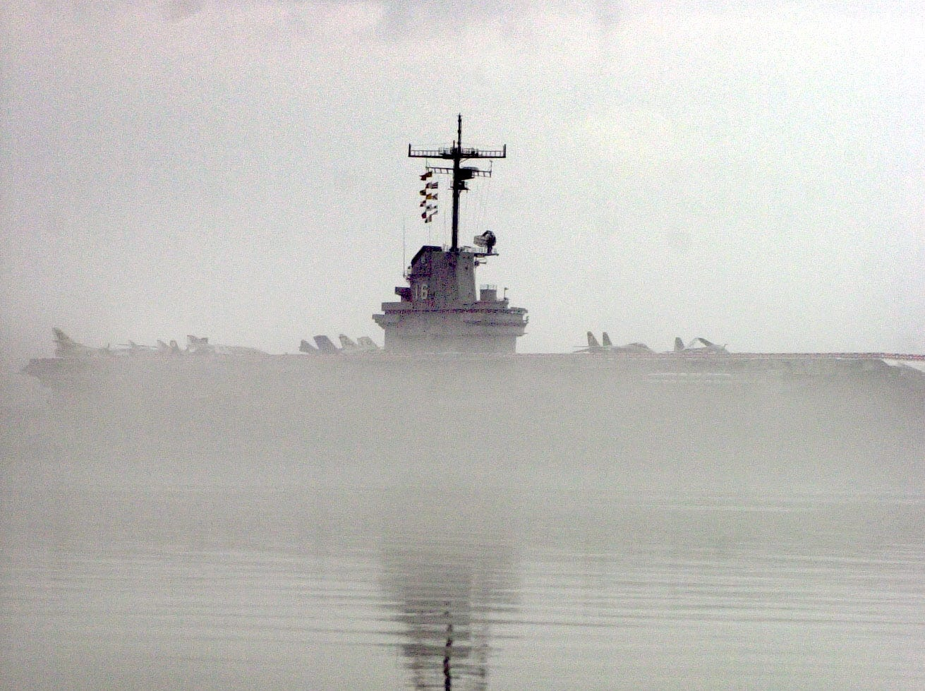 As the fog rolls in on Corpus Christi Bay it washes over the U.S.S. Lexington, leaving only the top of the ship visible Wednesday morning, Dec. 14, 2005.