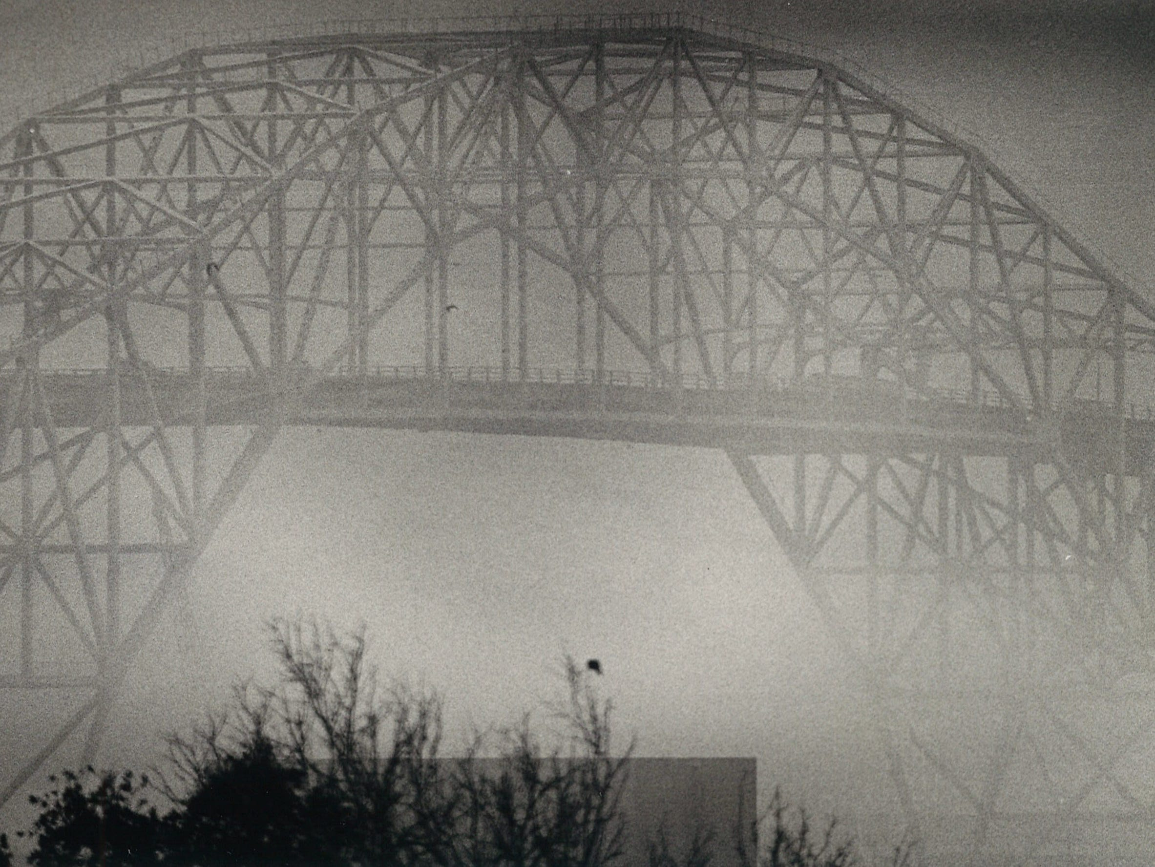 The Harbor Bridge looms in the fog in Corpus Christi on Jan. 29, 1985.