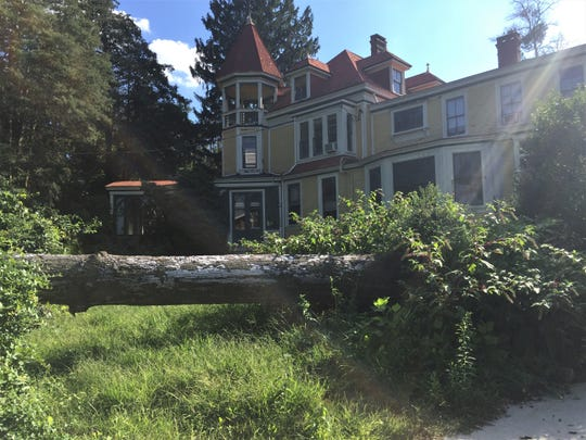 A fallen tree lies near the former headquarters of Bancroft in Haddonfield in a 2018 photo.