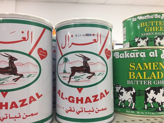 Varieties of ghee are available in cans at Ammon Mediterranean Market in Cherry Hill.
