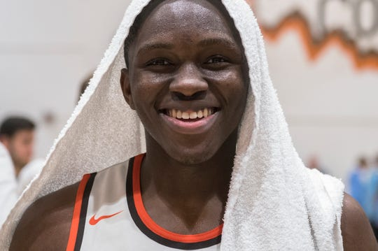 Cherokee's Olare Oladipo (4) smiles after a 54-38 win over Shawnee Monday, Feb. 25, 2019 at Cherokee High School in Marlton, N.J.