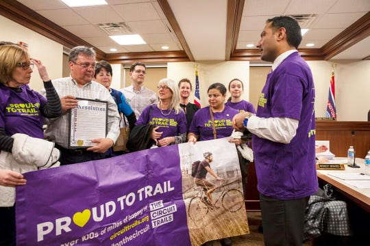 Circuit Trails supporters accept a Burlington County Board of  Freeholders resolution from Freeholder Balvir Singh this month. It commits the county to build more bike trails as part of a regional bicycle network in New Jersey and Pennsylvania.