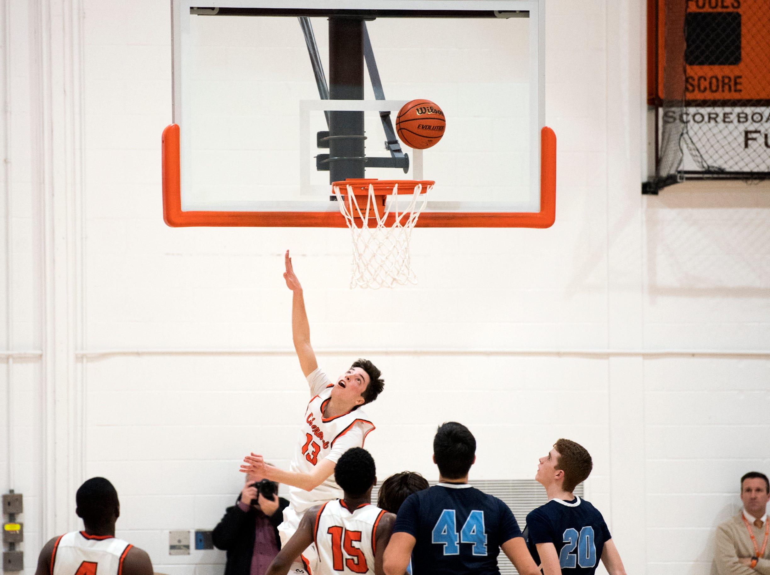 Cherokee's Anthony DiCaro (13) attempts a basket against Shawnee Monday, Feb. 25, 2019 at Cherokee High School in Marlton, N.J. Cherokee won 54-38.