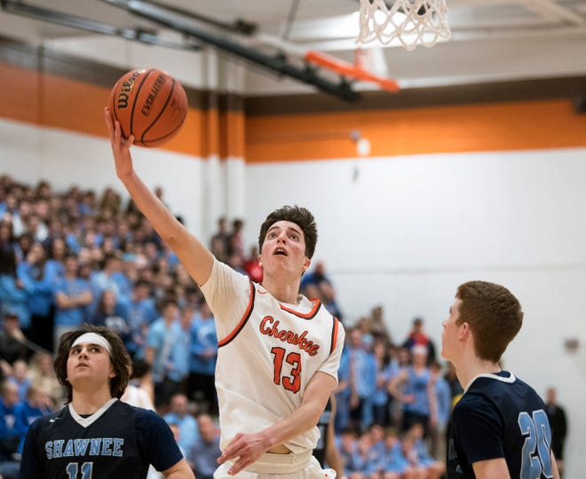 Cherokee's Anthony DiCaro (13) attempts a basket against Shawnee Monday, Feb. 25, 2019 at Cherokee High School in Marlton, N.J. Cherokee won 54-38.