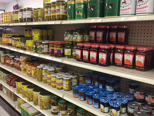 Preserves, pickled vegetables, ghee and other items line the shelves of Ammon Mediterranean Market.