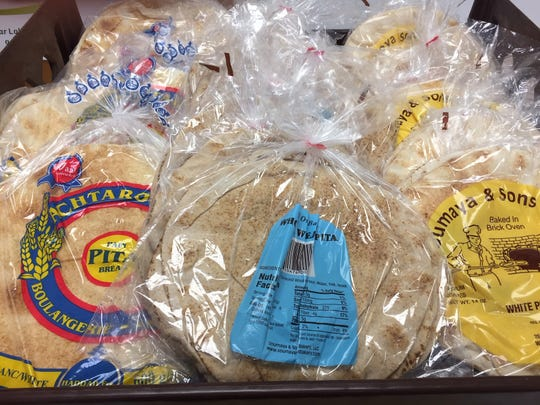 Bags of pita are delivered to Ammon Mediterranean Market in Cherry Hill twice a week.