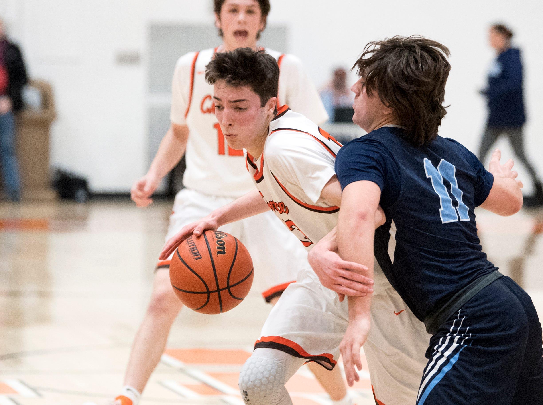 Cherokee's Anthony DiCaro (13) maneuvers past Shawnee's Cole Fleming (11) Monday, Feb. 25, 2019 at Cherokee High School in Marlton, N.J. Cherokee won 54-38.