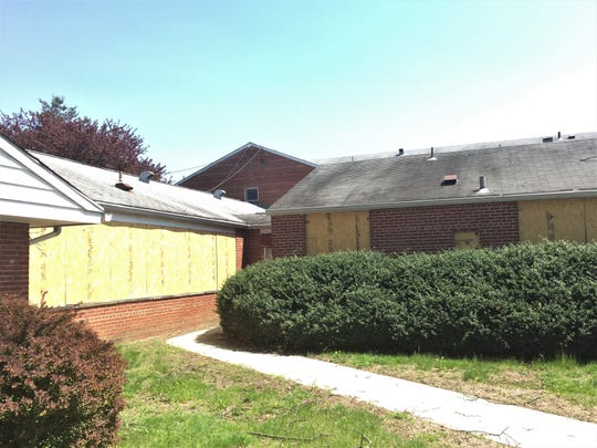 Boarded-up buildings await demolition at the former Bancroft site in Haddonfield.