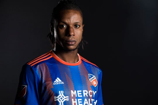 FC Cincinnati forward Darren Mattocks  poses for a photograph at FC Cincinnati's media day on Tuesday, Feb. 26, 2019, in Cincinnati.
