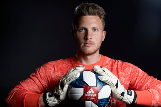 FC Cincinnati goalkeeper Spencer Richey  poses for a photograph at FC Cincinnati's media day on Tuesday, Feb. 26, 2019, in Cincinnati.