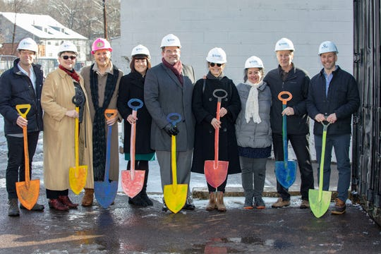 Holding cardboard shovels at the groundbreaking of ArtYard's new home were architect Ed Robinson; Kandy Ferree, managing director of ArtYard; Freeholder Suzanne Lagay; Frenchtown Borough Council President Michele Liebtag; Frenchtown Mayor Brad Myhre, Mayor; Jill Kearney, founder and executive director of ArtYard; Elsa Mora, artistic director of ArtYard; architect William Welch and contractor Bill Cumby III, president  of W.S. Cumby, Inc.