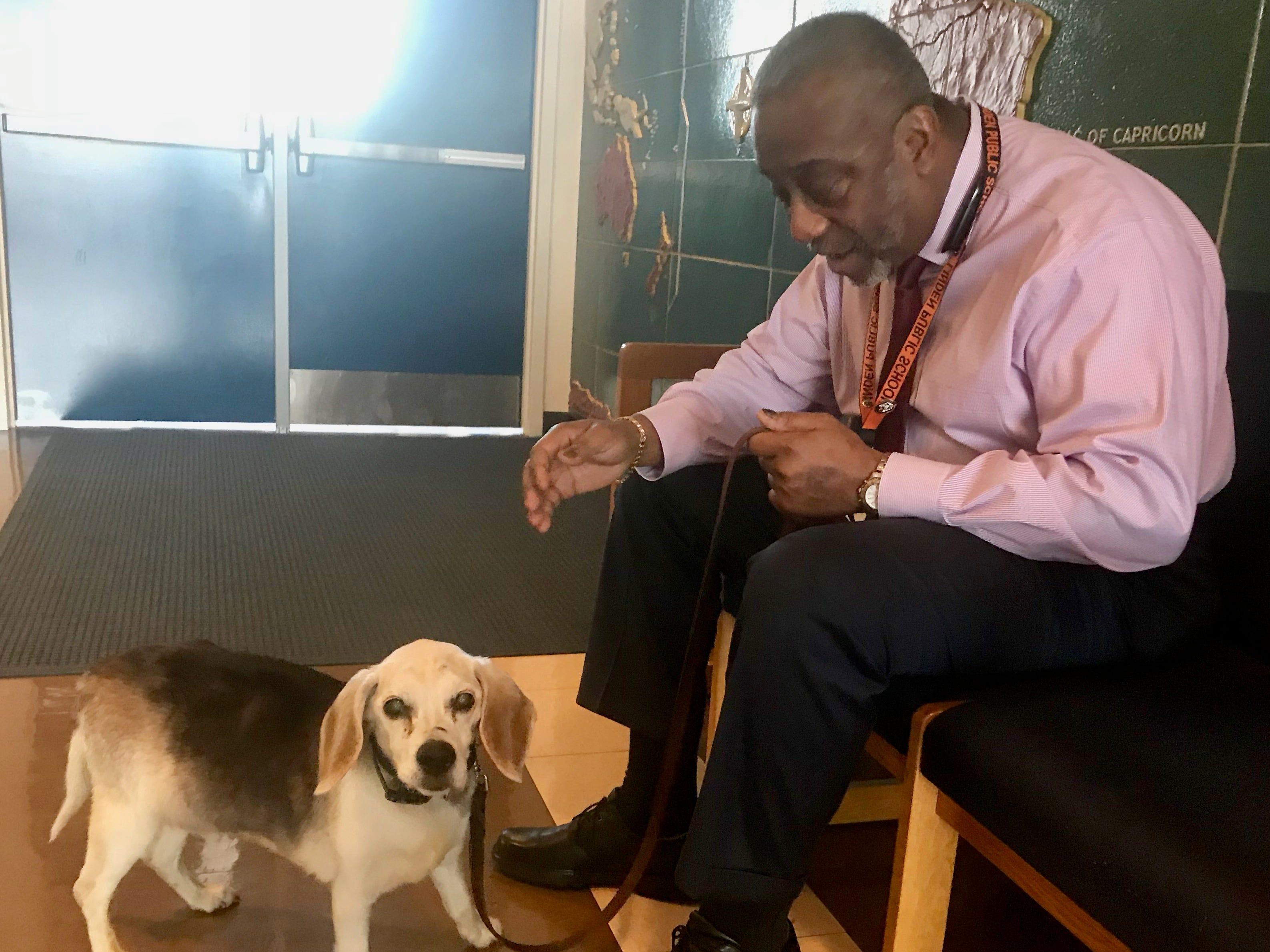 Buster with Deerfield School No. 9 Principal Larry Plummer.